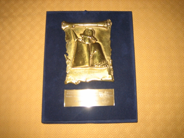 The Gold Prize for Scientific Discoveries received by Prof. Santilli from the Foundation Mediterranean on January 22, 2009, in Naples, Italy. The gold bassorilievo depicts and carries the script of a Gladiatore Sannita, namely, a gladiator from the Italian region of Sannio in central Italy where Prof. Santilli was born.