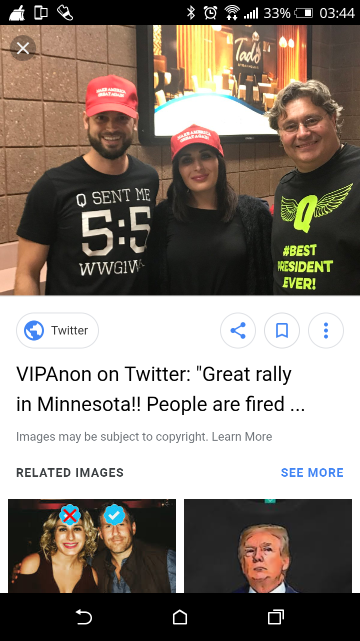 Laura Loomer posing with Qanon fans